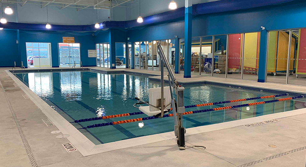 Indoor teaching pool with accessibility lift at Goldfish Swim School in Burlington, Ontario