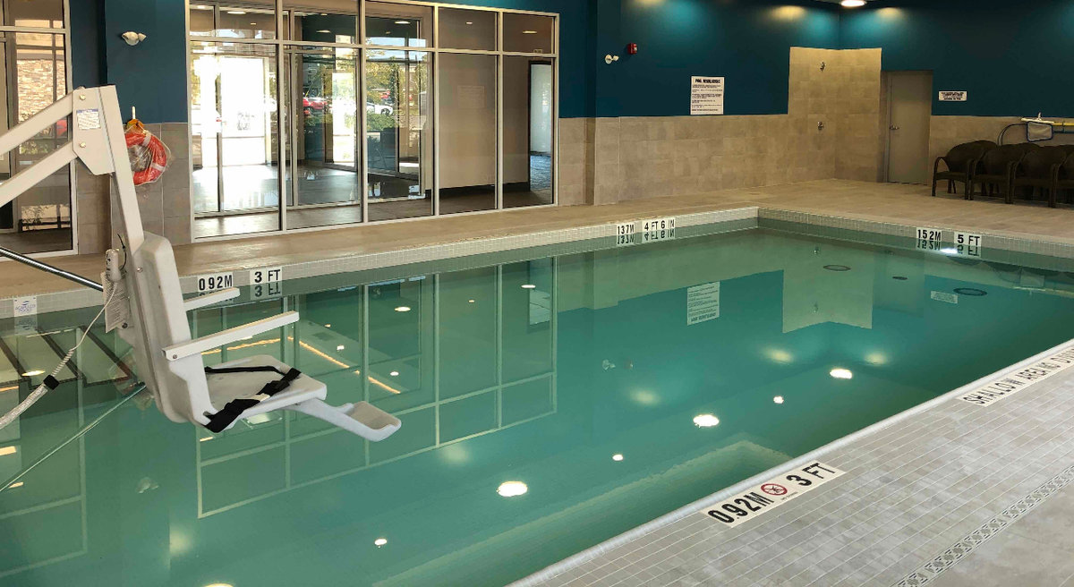 Indoor leisure pool with accessibility pool at Hampton Inn & Suites in Waterloo, Ontario