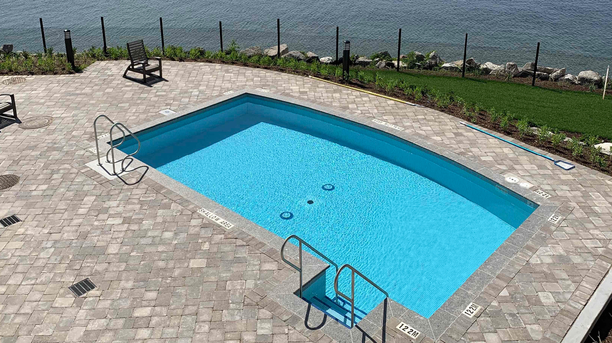 Lakeside pool at Orchard Point Harbour Condos in Orillia, Ontario