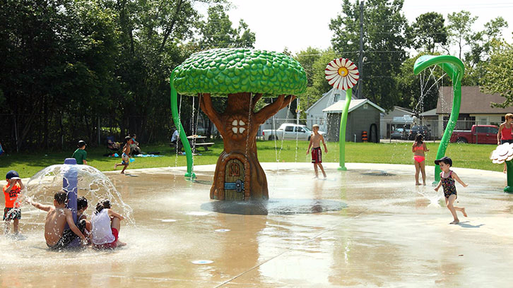 Kids playing at the Parkdale Playground splash pad